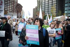 """Protester holds sign that reads """"Trans Rights Are Human Rights"""""""